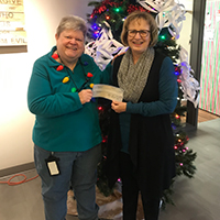 Betty Fiegen Presents Check to Hospital